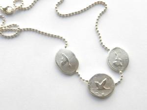 Kraniche - Kette mit 3 Gussstücken 935/925 Silber